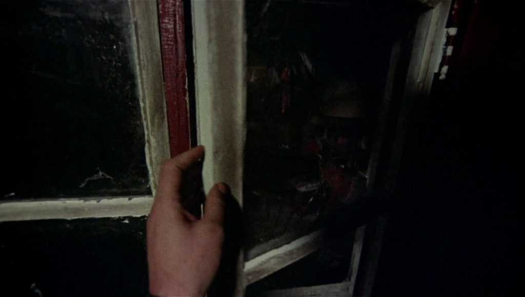 The killer sneaks into a second-story window in Black Christmas. (Warner Bros.)